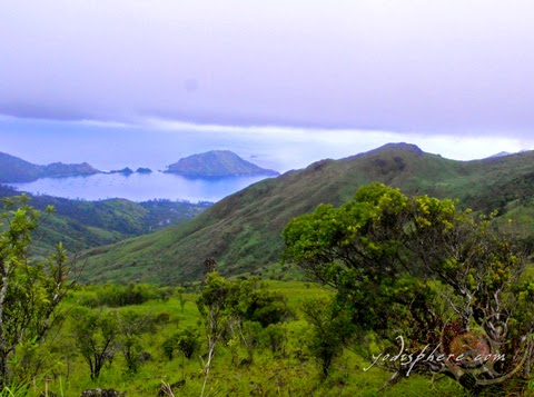 Amazing view of Silanguin Cove from the top of Mt. Cinco Picos hover_share