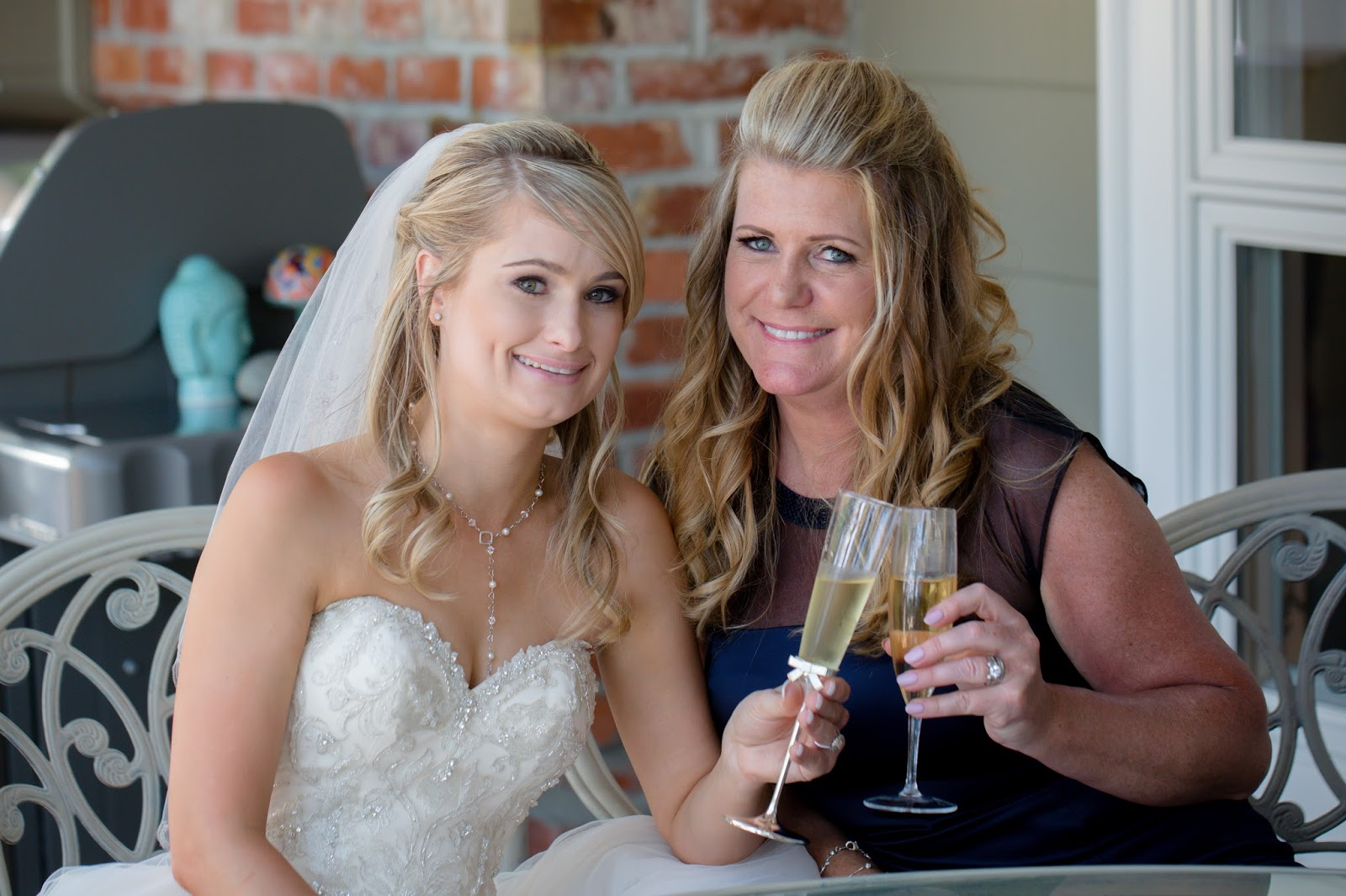 Bride and mother of bride with drinks