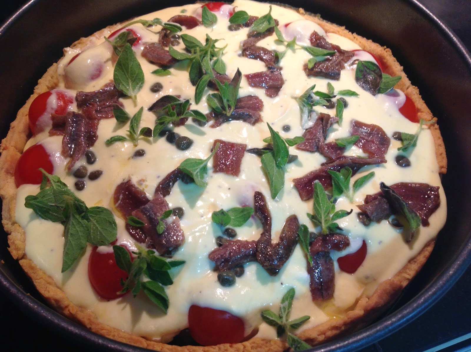 Mediterranean tart (eggplant, cherry tomatoes and ricotta) before baking