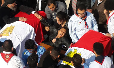 A grieving mother at the funeral of El-Botroseya Church bombing