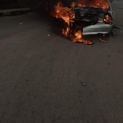 Photos: Young man drives car to Akwa Ibom House of Assembly complex, sets it on fire and flees