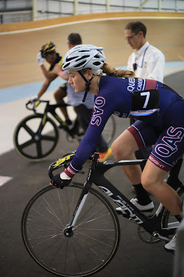 Female cyclist racing Madison of Melbourne track event