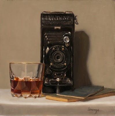 Vintage camera, glass of bourbon, classic movie dialogue