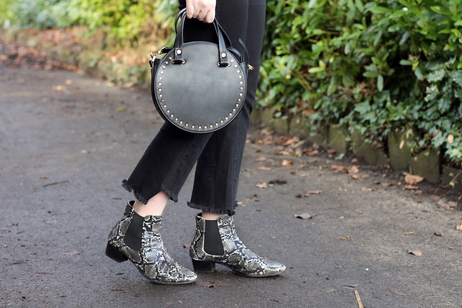structured round cross body bag in black topshop with snake print ankle Chelsea boots