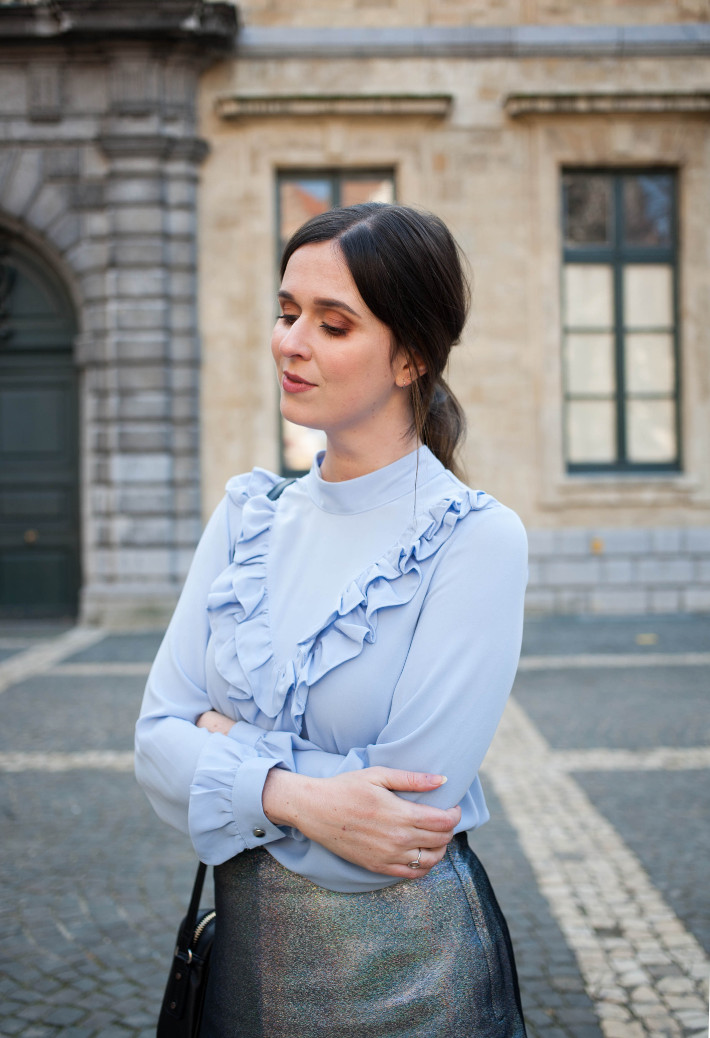 Outfit: ruffled blouse, silver holo skirt