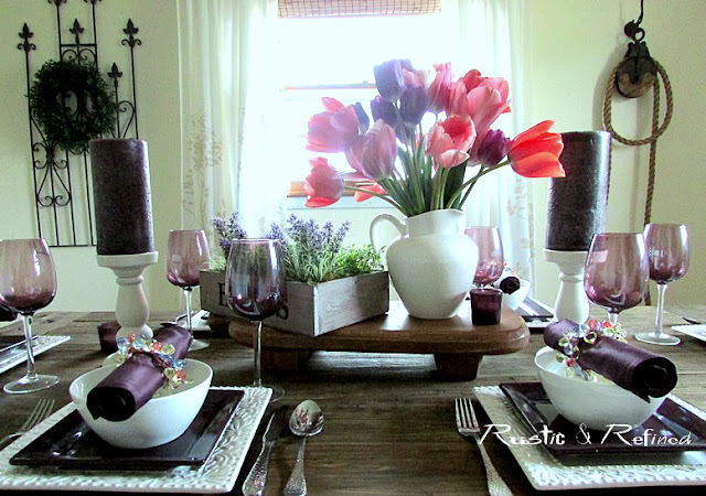 spring tablescape with white and purple dishes