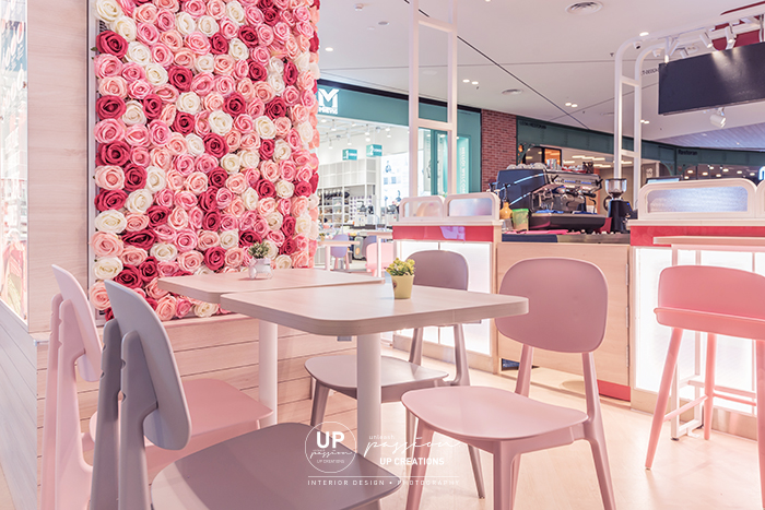 Central i city vanilla mille crepe kiosk highlighted area with floral, led neon signage and pastel color seating area