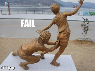 STATUE ERROR sticking fingers up childs bottom
