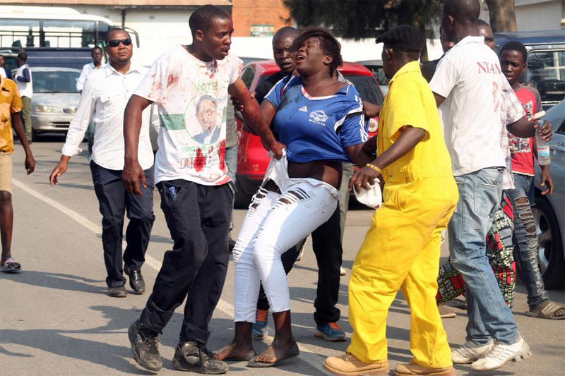 Photos: Football argument ends bloody as lady smashes man's head with bottle