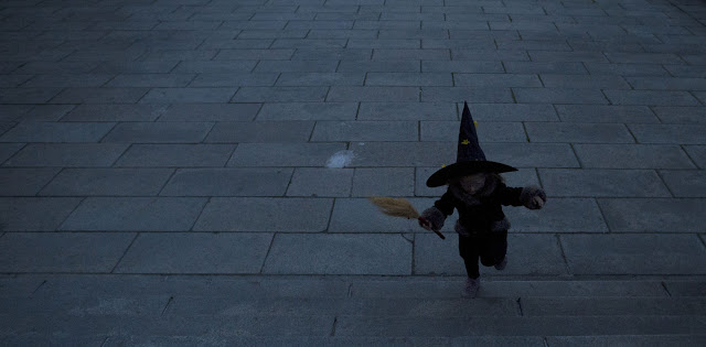 Child dressed as a witch for Halloween