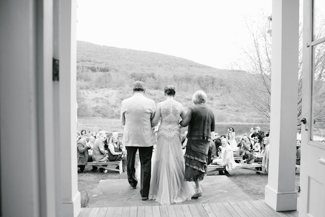 Bride walks down the aisle with her parents at Jonna and Heather's Inn at West Settlement Wedding by Karen Hill Photography