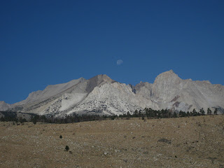 Moon setting over jagged peaks near Aspendell, California