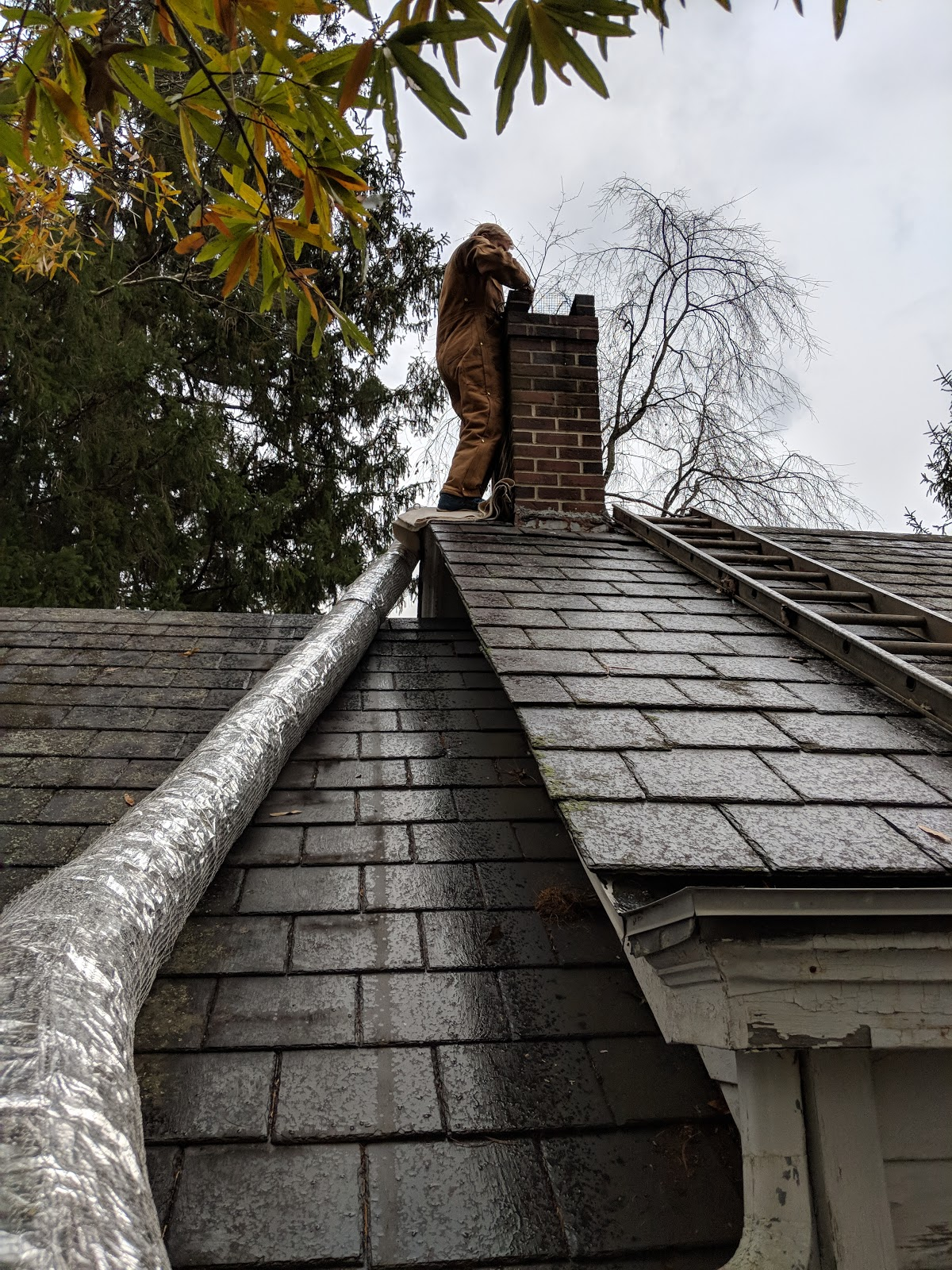 An Old Farm Installing A Chimney Liner
