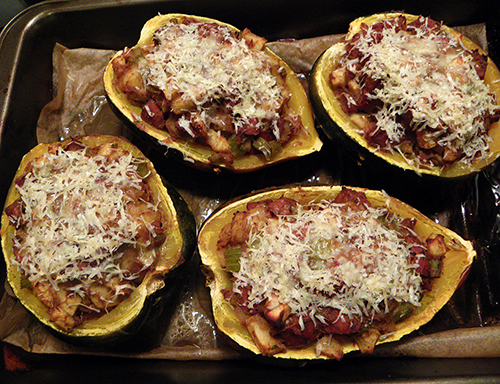 Four Stuffed Half Squashes, Baked and Topped with Cheese