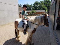 Grand son on horseback; courtesy of Lis Vaessen