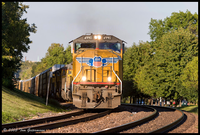 Up 4990 leads an autorack train west on the Jefferson City Subdivision at Maplewood, MO.