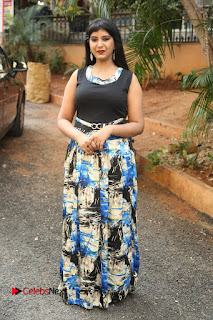 Actress Model Poorni Stills in Floral Long Dress at Silk India Expo Launch  0031.JPG