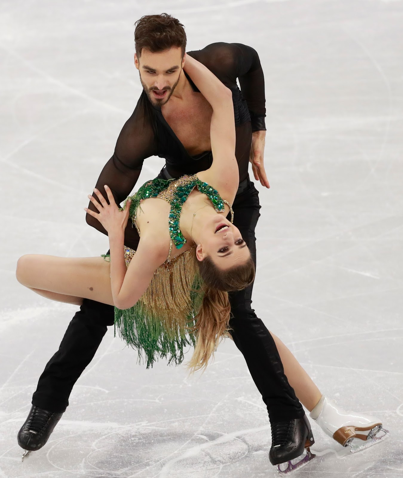 Olympic Curling Medalist From Russia Busted For Doping; Wardrobe Malfunction Leaves French Ice Dancer Exposed.