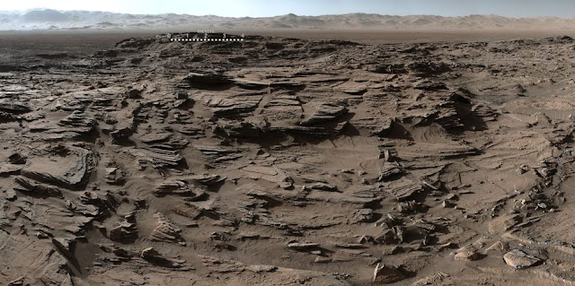"This 360-degree panorama from the Mastcam on NASA's Curiosity Mars rover shows the rugged surface of ""Naukluft Plateau"" plus upper Mount Sharp at right and part of the rim of Gale Crater. Credit: NASA/JPL-Caltech/MSSS"