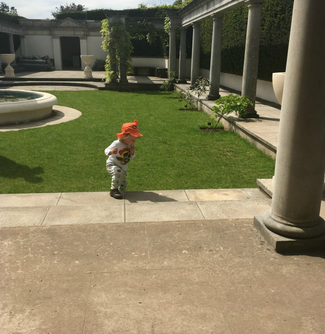 toddler-in-Pompeiian-garden-Dyffryn-Gardens