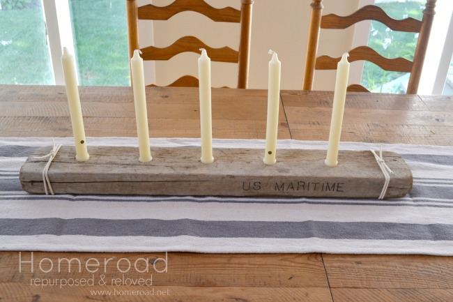 Using found driftwood to create a centerpiece candle holder for a farmhouse table www.homeroad.net