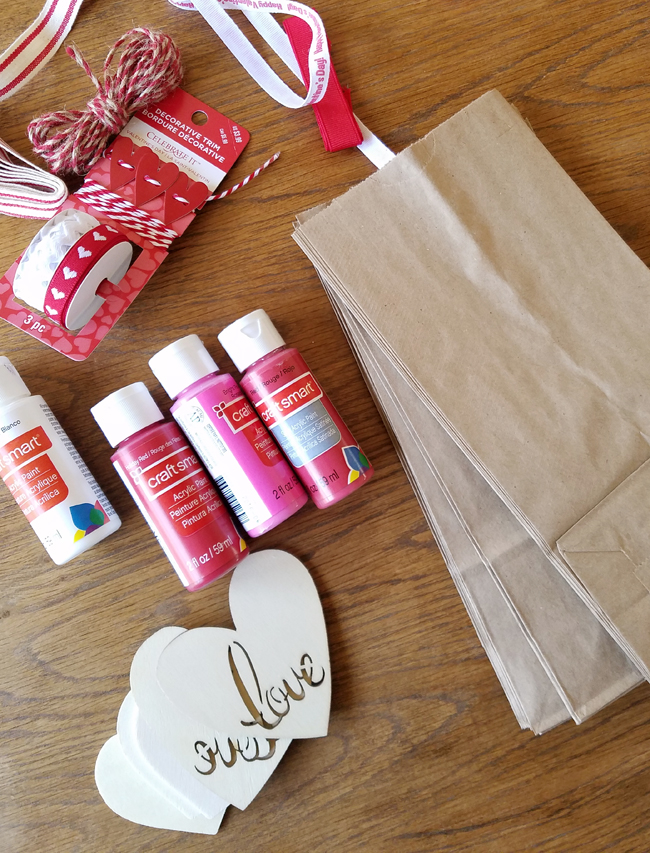 acrylic paint, paper lunch bags, ribbon, wooden heart shapes
