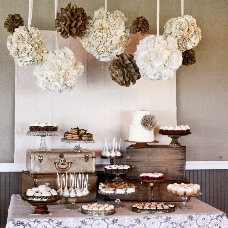 These hanging burlap and lace poms add some dramatic elegance for party decor