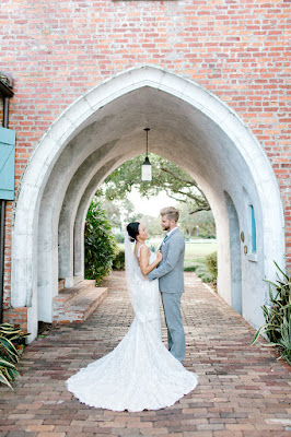 bride and groom under archway