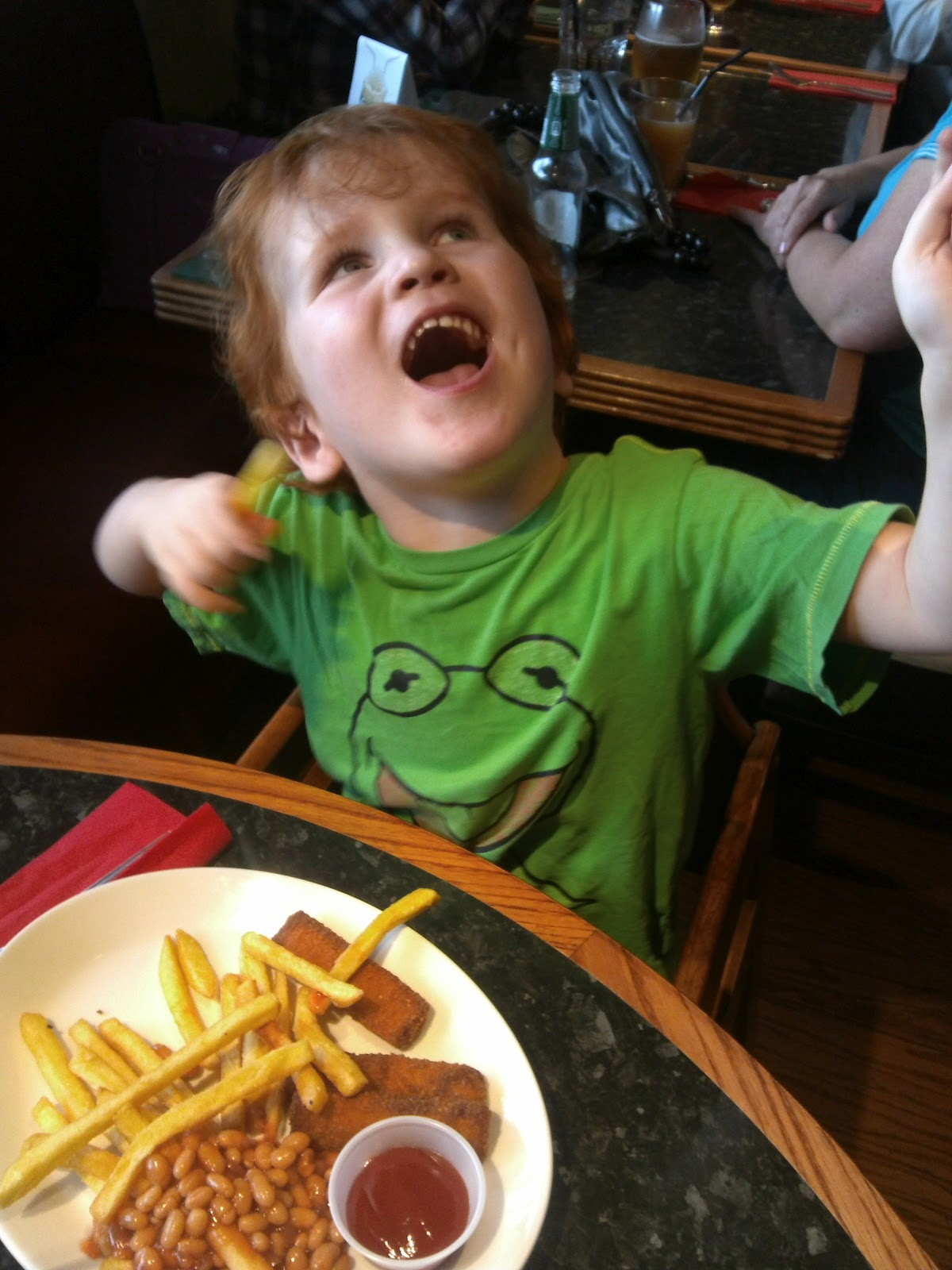 Ieuan enjoying his fishfingers, chips & beans at Frankie & Benny's