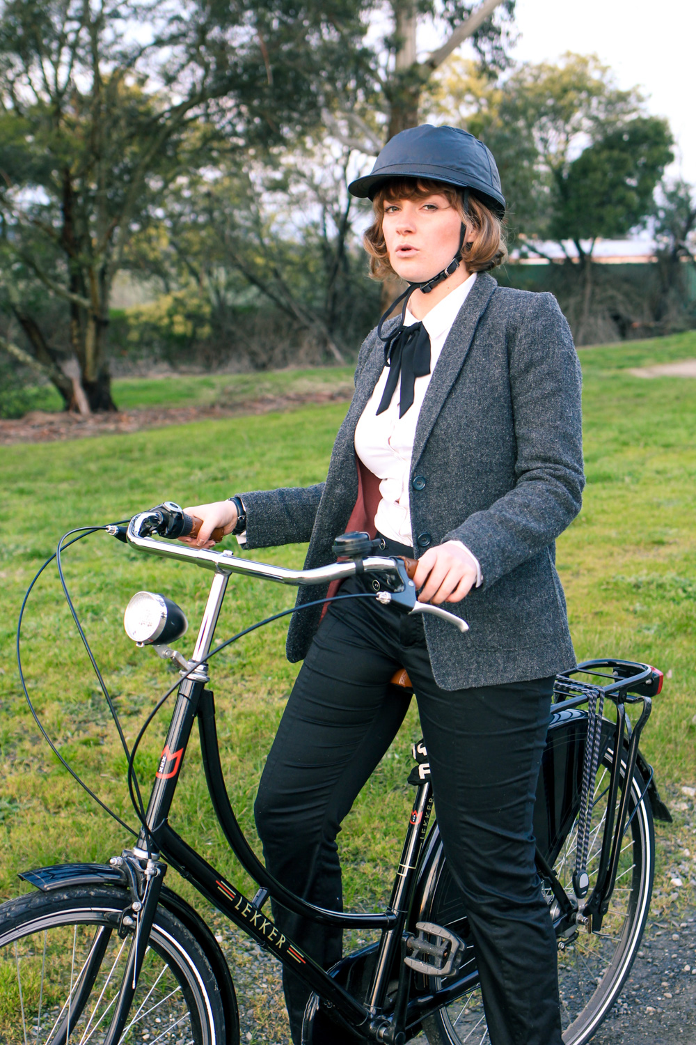 @findingfemme styles women's preppy cycling and bike fashion