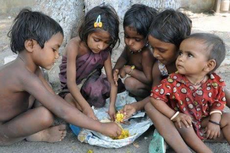 Poor Indian kids sharing food.