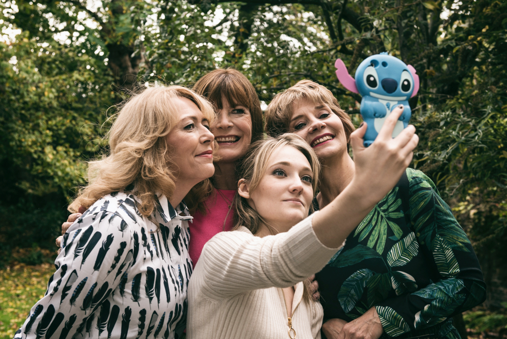 Image showing three over 40 fashion bloggers posing for a selfie with Jacynth Bassett the founder of The Bias Cut dot com