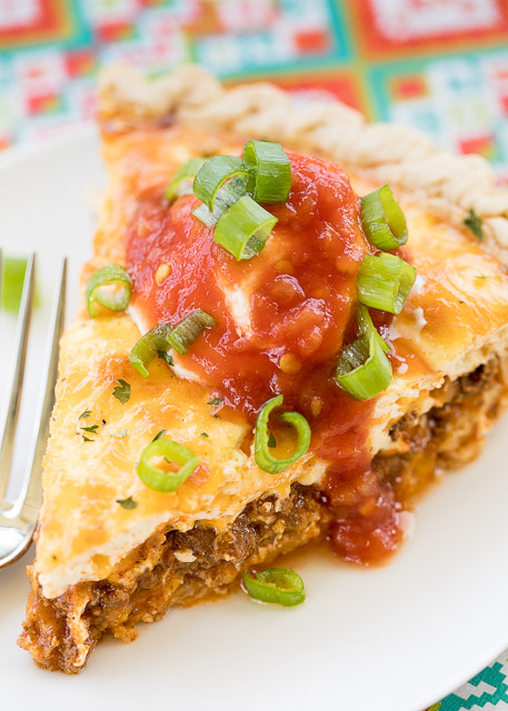 Taco Quiche - quiche loaded with taco meat, salsa and cheese. Top with your favorite taco toppings for a fun twist to taco night! Can assemble quiche and freeze unbaked for a quick meal later. I like to double the recipe and bake one and freeze one for later. Everyone LOVES this easy recipe! There are never any leftovers!!  Ground beef, taco seasoning, salsa, cheddar cheese, milk, eggs, sour cream. SO simple and it tastes AMAZING!