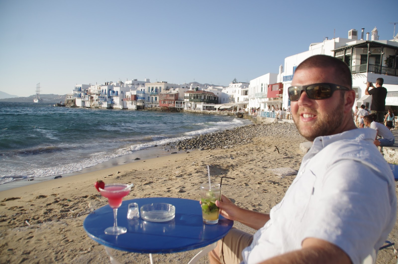 Male having cocktails at Little Venice Mykonos