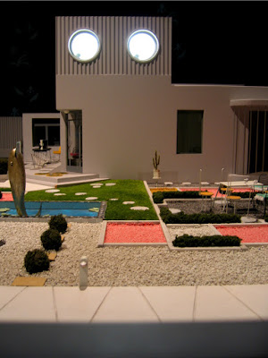 Model of a modernist villa from the film 'Mon Oncle' with a garden containing a pond with a fish fountain in the middle.