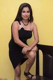 Vrushali Gosavi in strapless Short Black Dress At Follow Follow U Audio Launch 041.JPG