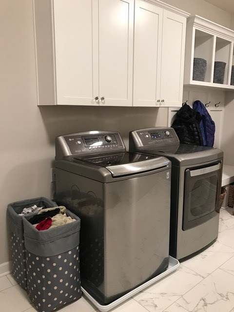laundry with gray washer and dryer
