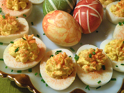 Platter of Deviled eggs with Easter Eggs in Background
