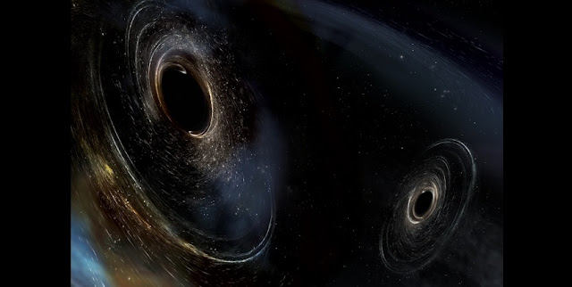 This artist's conception shows two merging black holes similar to those detected by LIGO. The black holes are spinning in a nonaligned fashion, which means they have different orientations relative to the overall orbital motion of the pair. LIGO found hints that at least one black hole in the system called GW170104 was nonaligned with its orbital motion before it merged with its partner.  Image: LIGO/Caltech/MIT/Sonoma State (Aurore Simonnet)