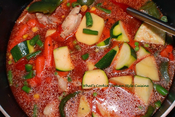 his is a stew made with all fresh vegetables and burgundy wine.  this is an easy Chicken  stew in a microwaveable white corning ware dish and Italian bread on the side