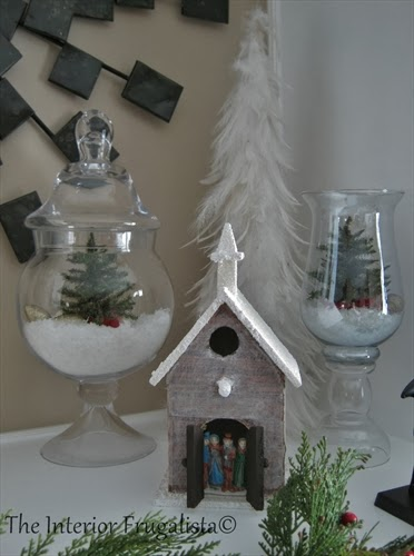 Apothecary jars decorated in mini snowscapes for the holidays
