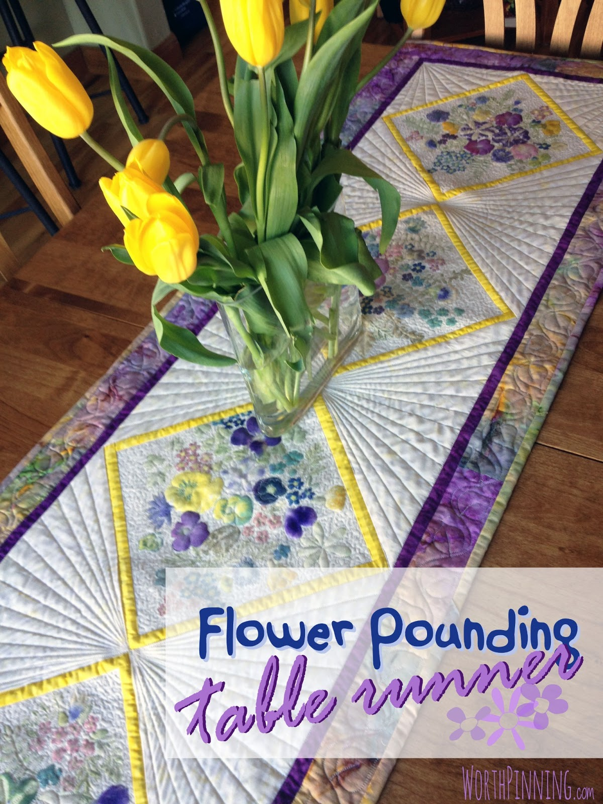 Flower pounding technique quilted floral table runner for The fabric of reality