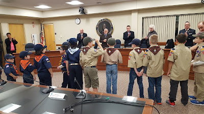 Cub Scout pack 17 get applause after leading the Pledge of Allegiance