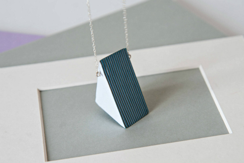 Triangular layered paper pendant necklace in shades of blue and white with silver chain