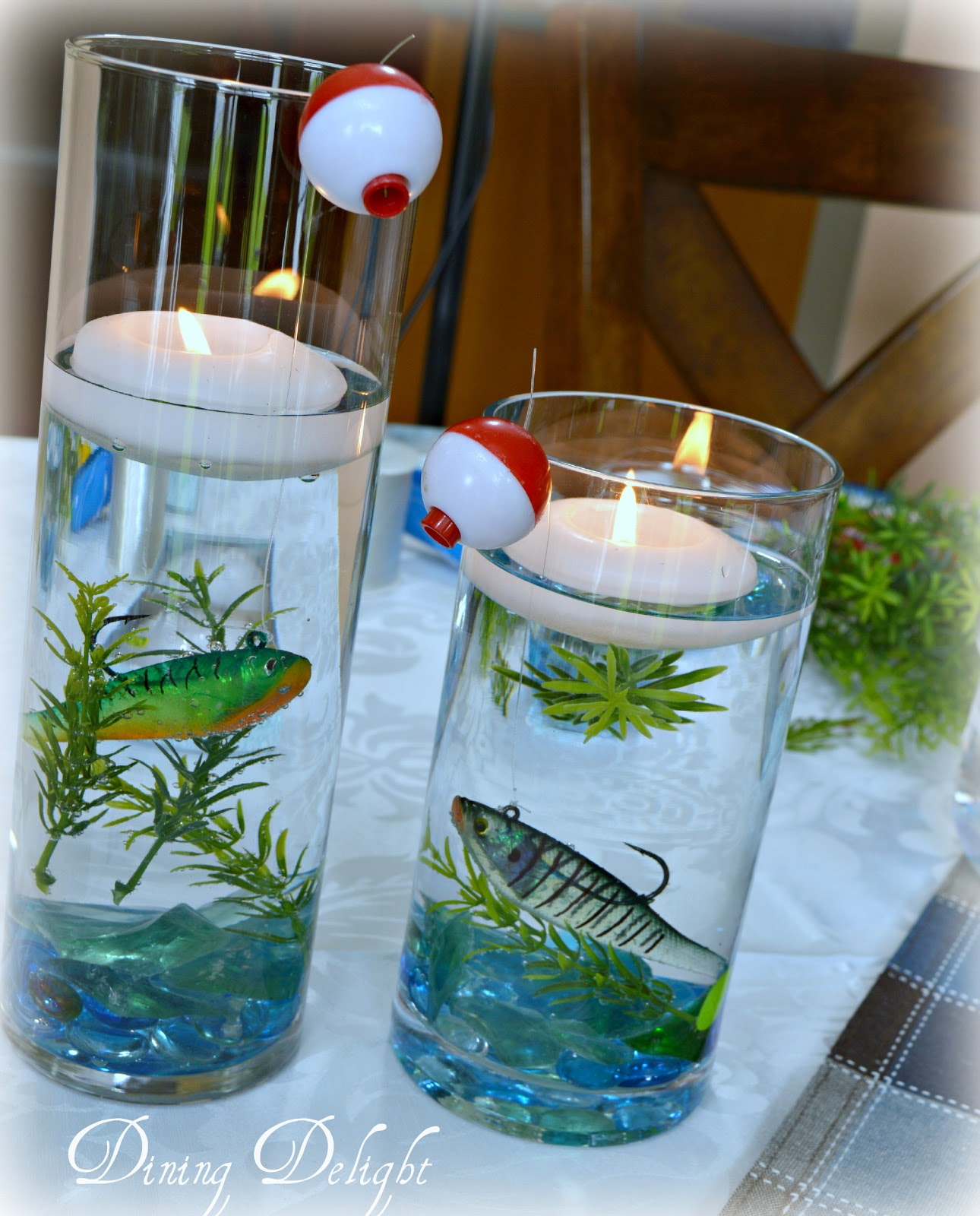 Dining delight fishing centerpiece in cylinder vase