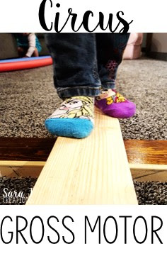 Make a simple balance beam with 2x4s to practice balance and gross motor skills during a circus unit.  Perfect for a rainy day!
