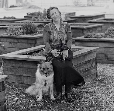 Carol J. Adams with Inky (on lap) and Holly at the Encore Park Community Garden, Dallas, Texas