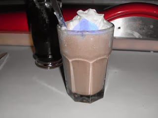 Space Monkey- Sci Fi Dine In Theater The Recipes Of Disney Ingredients 1 ounces chocolate milk shake 3/4 ounce coconut rum 3/4 ounce creme de banana liqueur Directions Put all ingredients in a blender and mix well.
