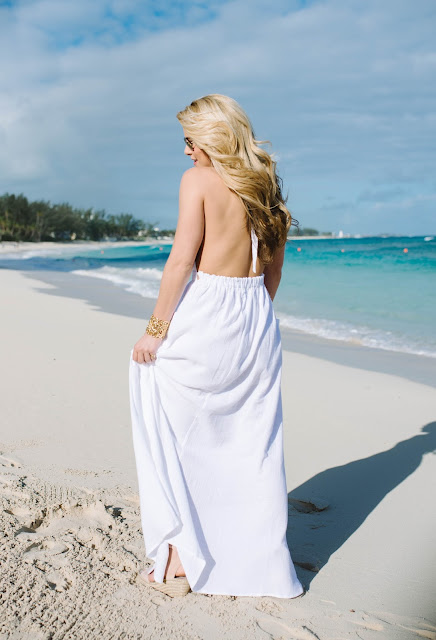 white maxi dress on the beach