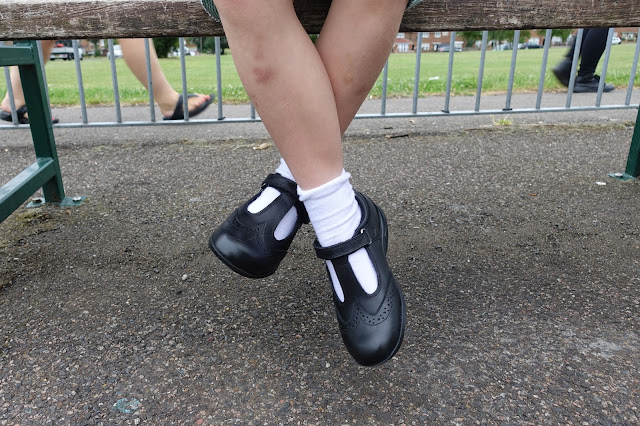 A pair of bruised legs, white socks and Term Footwear school shoes